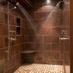 Custom slate tile shower with mosiac tile flooring in Breckenridge, MN. Installed by Pro Floor & Tile.